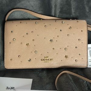 Coach Foldover Jax crossbody with moon and stars